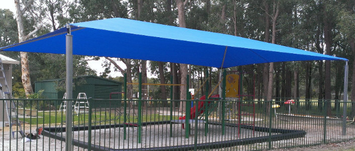 Shade sail over childrens play area image
